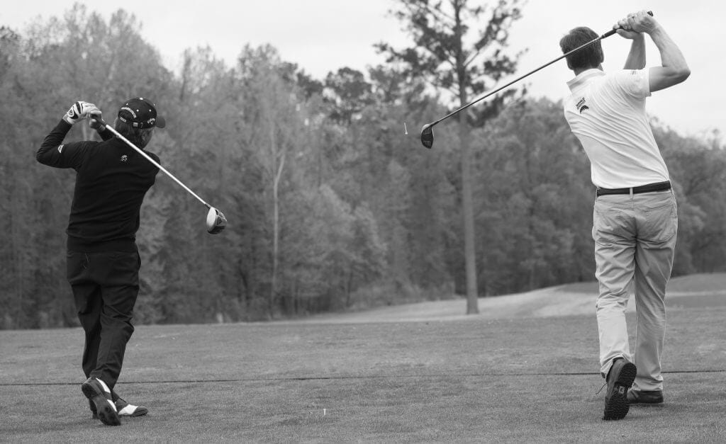 Image of me (Jeremy Dale) hitting drives at the same time, side-by-side with Gary Player.